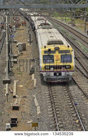 Bombay, India - June 10, 2016: Bombay Local Train changing track near Andheri railway station during megablock on western line,Bombay,Maharashtra