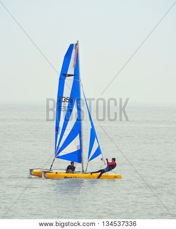 Felixstowe, Suffolk, England - June 11, 2016: Colorful Dart 16 Catamaran Sailing with 2 crew  at Felixstowe Suffolk England.