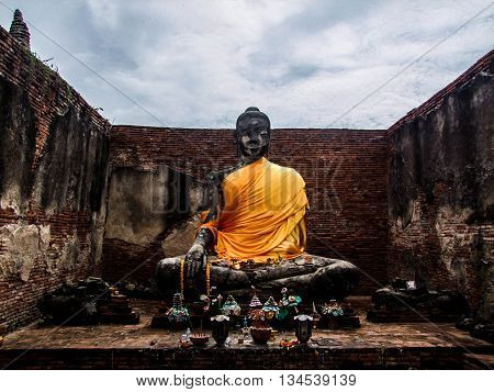 Buddha image in the abandoned temple at Ayutthaya , Thailand