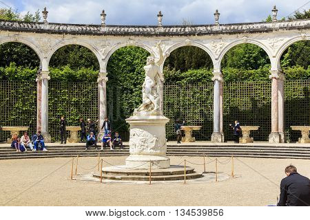 VERSAILLES, FRANCE - MAY 12, 2013: Bosquet Colonnade is a circle of 32 columns and arches in the center of the sculpture