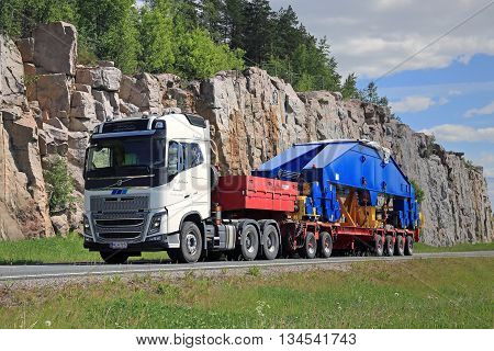 PAIMIO FINLAND - JUNE 6 2016: White Volvo FH16 750 transports shipyard crane component on trailer. The 48-tonne load is supported by 24 wheels.