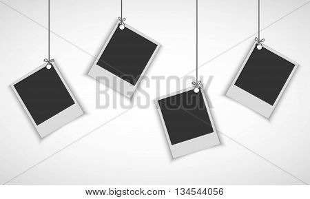 Blank photo frame hanging on line over white background