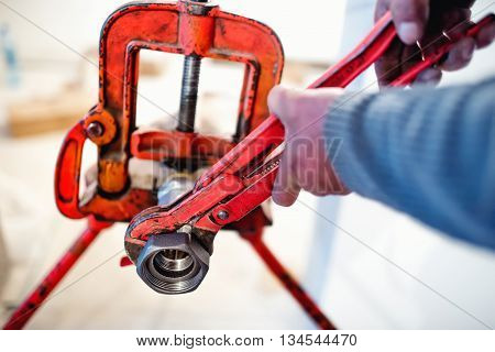 handyman plumber working with wrench and tools