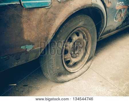 Close Up Flat Tire Of Old Car Park On The Street Waiting For Repair