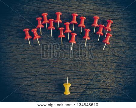Thumbtacks Pinned Arrange To Symbolize On Wooden Table To Be Different Or Leadership Or Bravery With