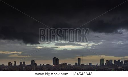 Cityscape of Bangkok before raining dark huge nimbus clouds and the city in the evening