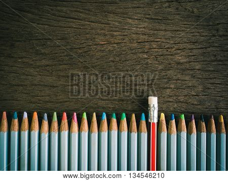 Colorful Pencil And Rubber Arrange On The Wooden Table Symbolized To Be A Forgiveness