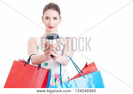 Attractive Woman Holding Shopping Bags Offering Takeaway Beverage