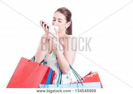 Woman Holding Shopping Bags Enjoying A Cup Of Coffee