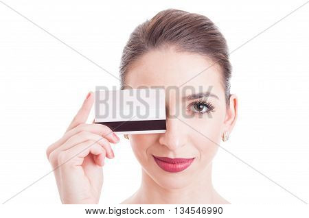 Young Woman Face With Eye Covered By Credit Debit Card