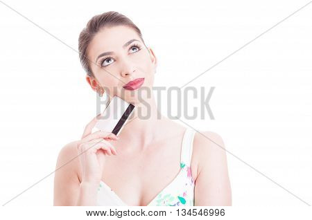 Attractive Woman Holding Credit Card And Feeling Pensive