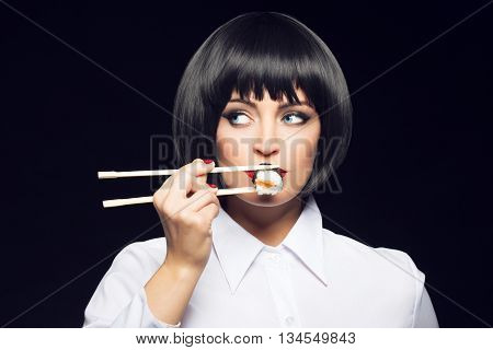 Gluttonous woman eating sush on black background vintage style