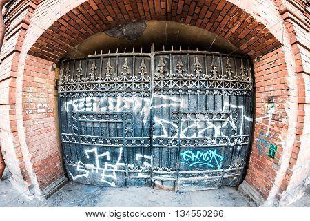 Yard Gate With Graffiti