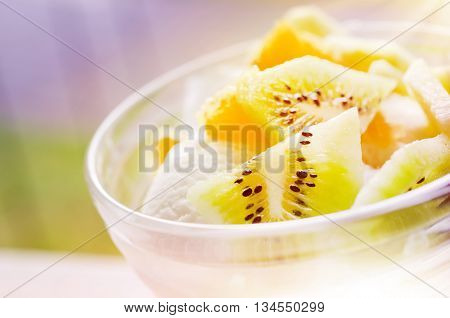 Vanilla Ice Cream With Fresh Kiwi and Orange Slices in a Glass Dish