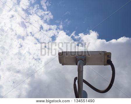 Surveillance Security Camera Or Cctv On Blue Sky Background