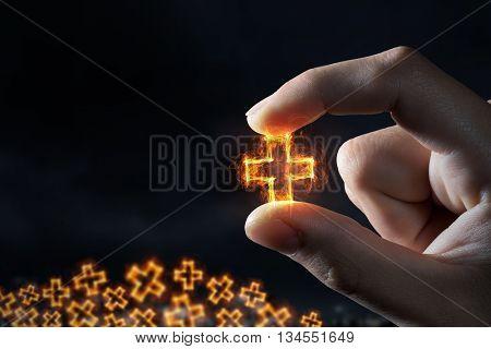 Cross symbol between fingers