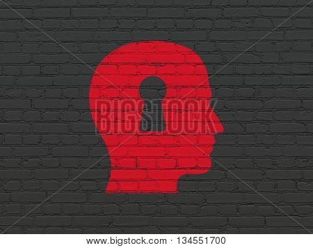 Advertising concept: Painted red Head With Keyhole icon on Black Brick wall background