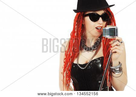 Modern rock singer singing into a microphone. Isolated over white.