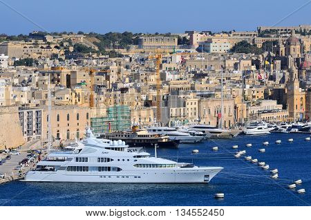 VALLETTA MALTA - APR 17 :Valletta Port in Malta April 17 2011. The Valletta port is a popular tourist attraction full of cafes and restaurants.