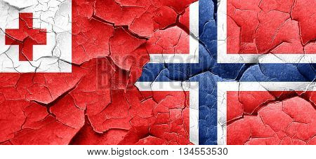 Tonga flag with Norway flag on a grunge cracked wall