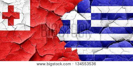Tonga flag with Greece flag on a grunge cracked wall
