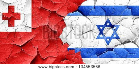 Tonga flag with Israel flag on a grunge cracked wall