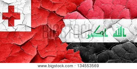 Tonga flag with Iraq flag on a grunge cracked wall