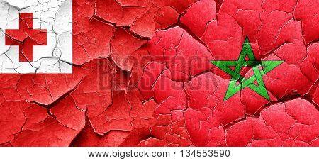 Tonga flag with Morocco flag on a grunge cracked wall