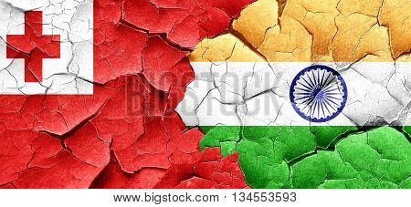 Tonga flag with India flag on a grunge cracked wall