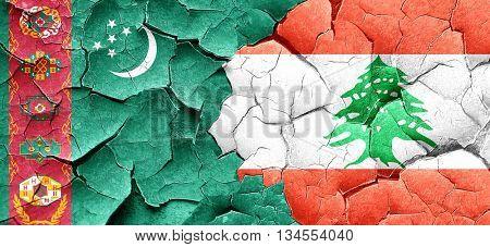 Turkmenistan flag with Lebanon flag on a grunge cracked wall