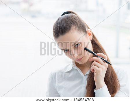 Friendly Business Woman Holding A Pen