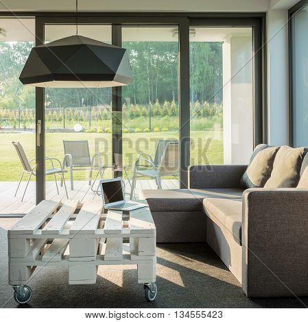Spacious living room with comfortable sofa and stylish table
