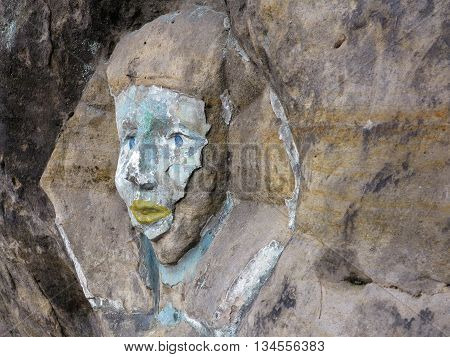 Rock relief - the face of the Sphinx - carved into the sandstone cliffs