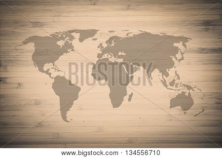 World map on surface detail of old grunge beige-brown vintage wood texture background use for backdrop or design element in save the earth or business travel concept