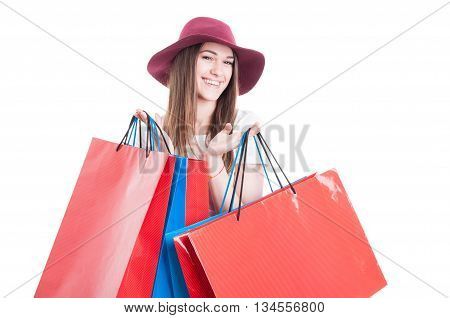 Portrait Of Stylish Shopper Holding Colorful Shopping Bags And Smiling
