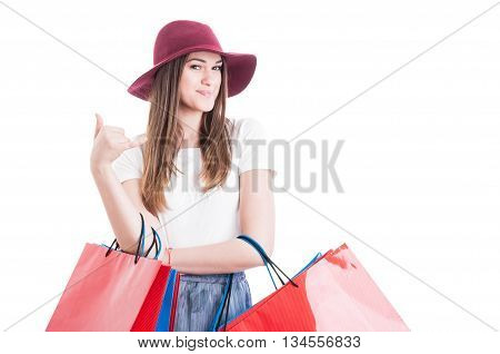 Pretty Stylish Shopaholic Doing A Calling Gesture With Hand