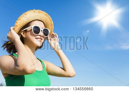 Young woman relaxing and watching sunlight at summer