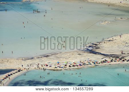 CRETE, GREECE - AUGUST 08: People relaxing at Balos beach in Crete, Greece on 08 August 2014. Balos beach is one of a famous beach in the Crete island.