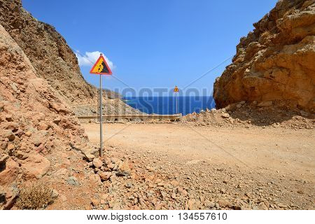 Gravel dangerous road on island of Crete in Greece