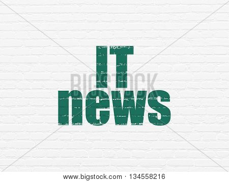 News concept: Painted green text IT News on White Brick wall background