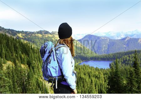 Woman tourist hiking. Mount Rainier national park Washington