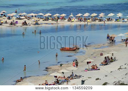 CRETE GREECE - AUGUST 08: People relaxing at Balos beach in Crete Greece on 08 August 2014. Balos beach is one of a famous beach in the Crete island.