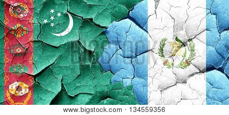 Turkmenistan flag with Guatemala flag on a grunge cracked wall