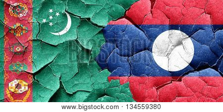 Turkmenistan flag with Laos flag on a grunge cracked wall