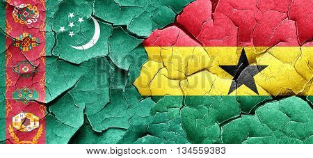 Turkmenistan flag with Ghana flag on a grunge cracked wall