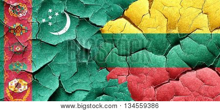 Turkmenistan flag with Lithuania flag on a grunge cracked wall