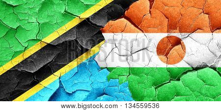 Tanzanian flag with Niger flag on a grunge cracked wall