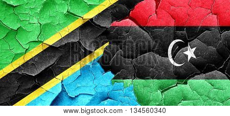 Tanzanian flag with Libya flag on a grunge cracked wall
