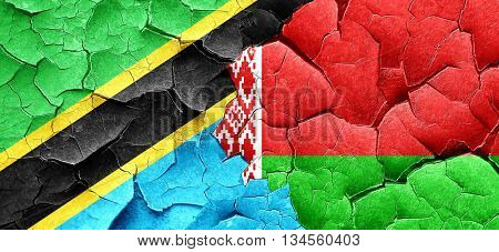 Tanzanian flag with Belarus flag on a grunge cracked wall