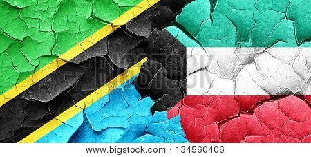 Tanzanian flag with Kuwait flag on a grunge cracked wall